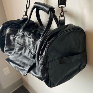 Brand new black leather duffel